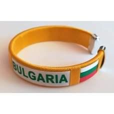 Жълта плетена сувенирна гривна с надпис България и знаме